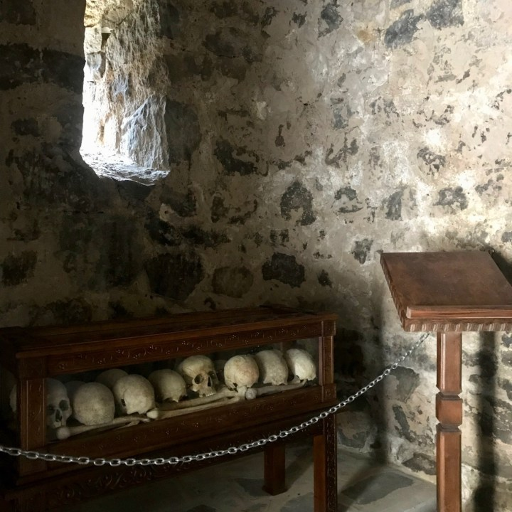 Vardzia Georgia with kids skulls
