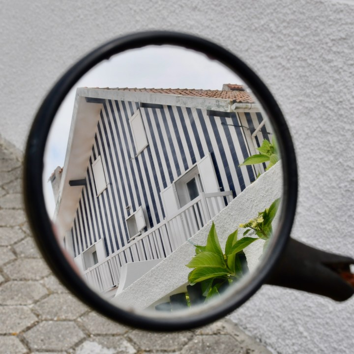 Costa Nova Portugal side street mirror view