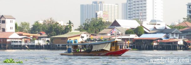 Various boats on Bangkok's Chao Phraya Water Taxi view