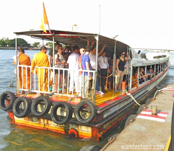 The water taxi coming in to accept new passengers. Bangkok Chao Phraya Water Taxi