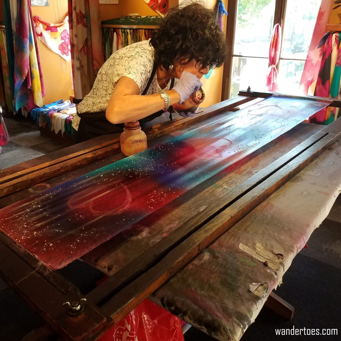 Dominique creating a silk scarf design in Soierie Huo.  Quebec City shopping artisan souvenirs.