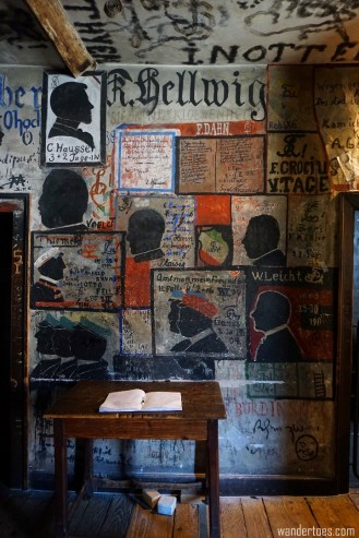 Grafitti'd common area in the prison, with a guest book where you can record your visit. Heidelberg Studentenkarzer Student Prison.