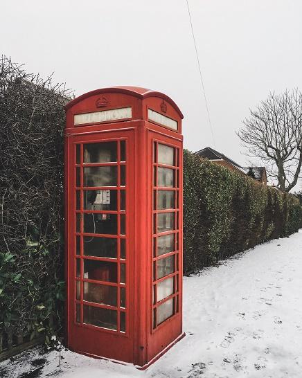 red phone box snow