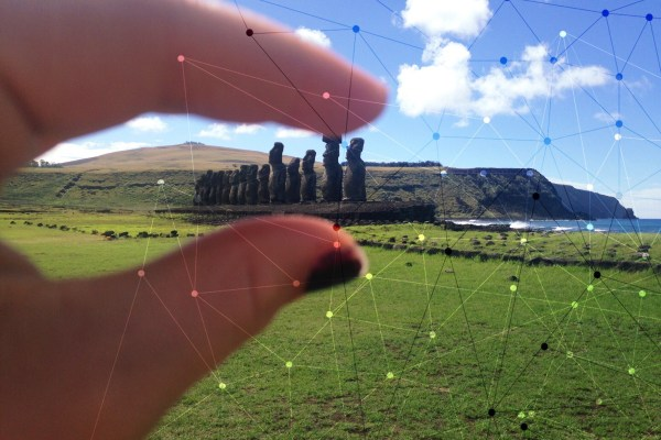 Easter Island between human fingers.