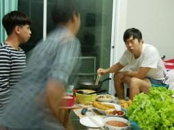 K.B. at our privte New Years celebration cooking korean food for us.// K.B., der bei unserer privaten Neujahrsfeier korianisch für uns kocht.
