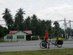 A man on a road.// Ein Mann auf einer Strasse.