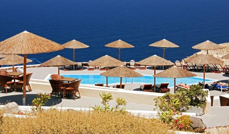 Pool overlooking Aegean Sea, Oia, Santorini, Greece