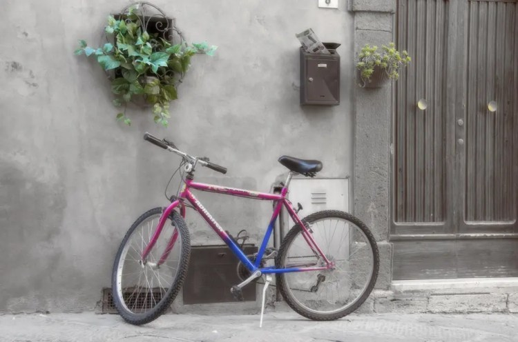 Bike in front of house, Pienza, Italy