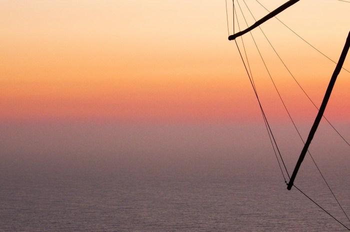 Sky at dusk with windmill, Oia, Santorini, Greece