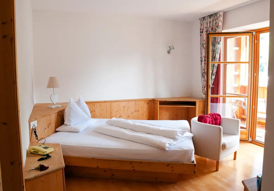 Bed and door to balcony