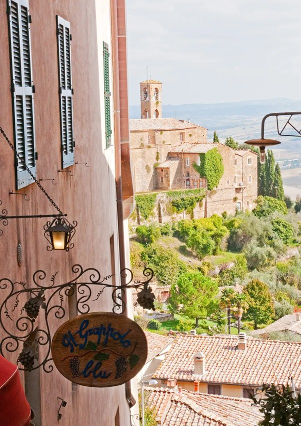 Sign for restaurant and view from Montalcino