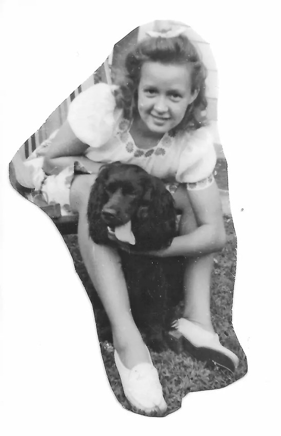 Mom as a young girl with her dog, Pepper