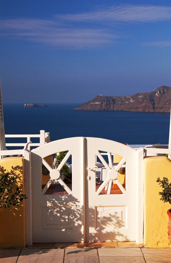 White gate to hotel terrace with view, Oia, Santorini, Greece