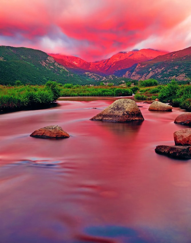 Pink sunrise at Rocky Mountain National Park with the Big Thompson River in the foreground, Colorado