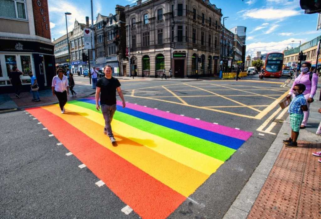 People crossing the rainbow crossing in Greenwich
