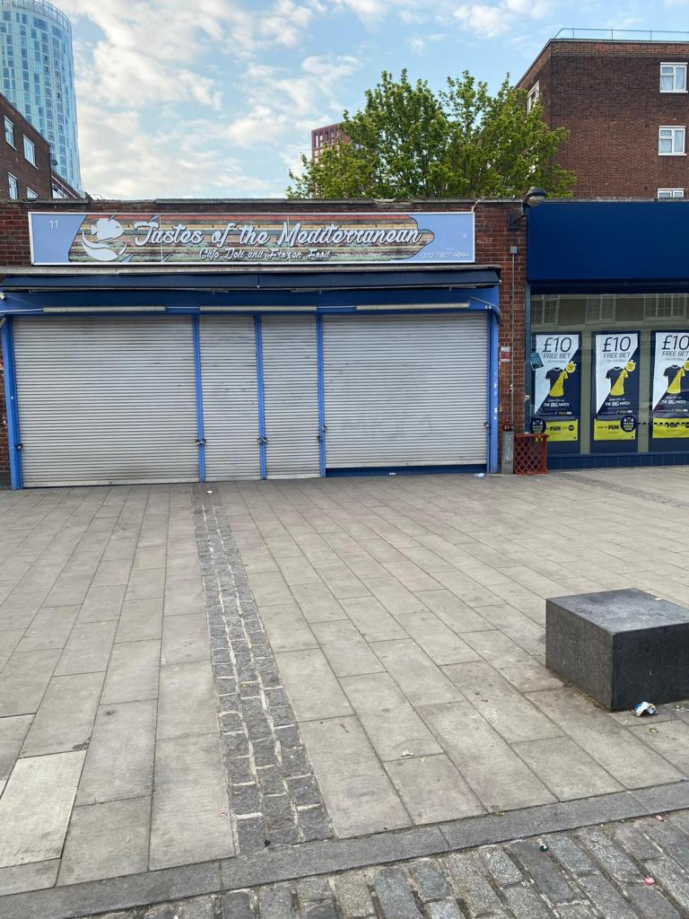 11 Wilcox Road today, the photo shows the exterior of a closed, shuttered cafe.