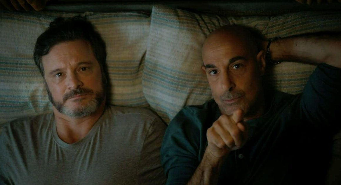 A scene from Supernova, the two main characters are laying next to each other in bed