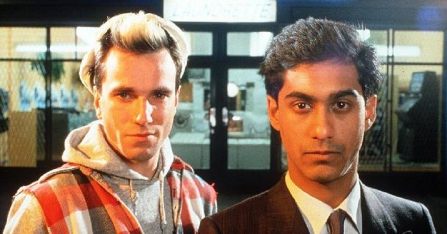 Johnny and Omar standing in front of the laundrette