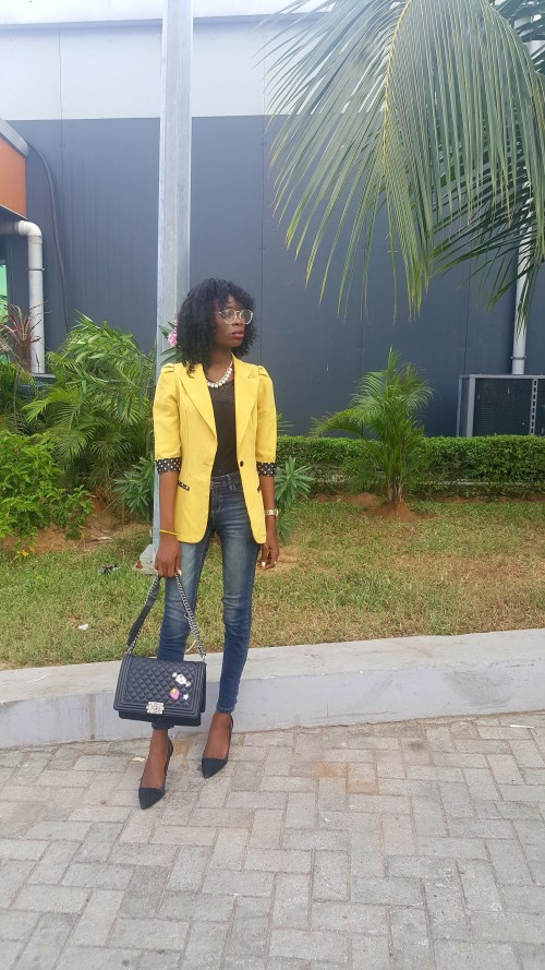 Black woman yellow blazer