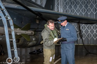 Signing for his aircraft