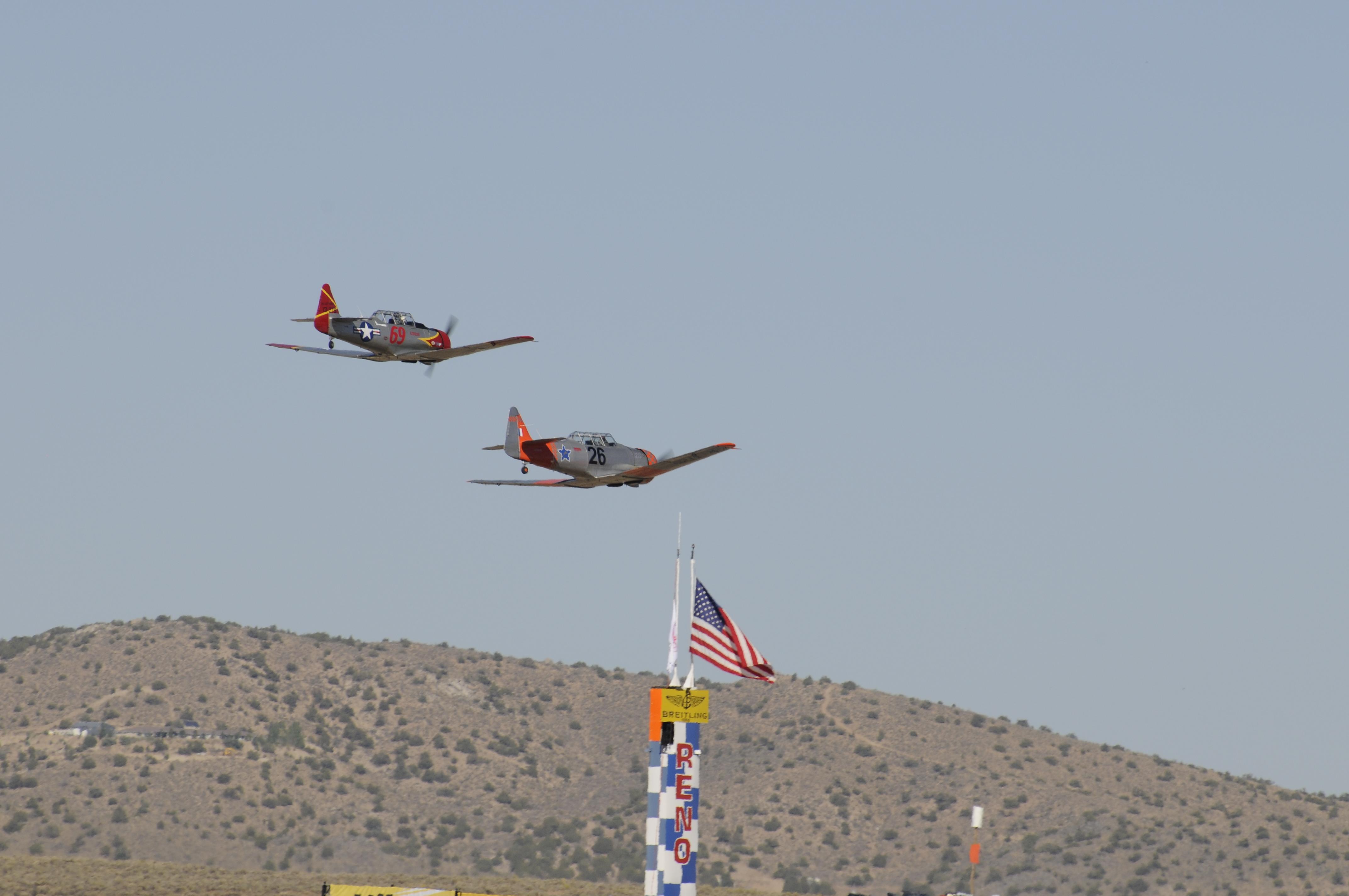 """T-6 Race #69 """"Eros"""", Pilot Lee Oman & Race #26 """"Happy Hour"""", Pilot Jim Thomas"""