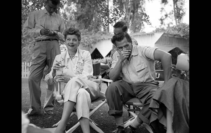 Sep. 12, 1953: Actress Lucille Ball laughs as her husband, Desi Arnaz, contemplates an answer at their press conference Saturday. They met newsmen after her Red link testimony was released. (Original published caption on Sep. 13, 1953.)
