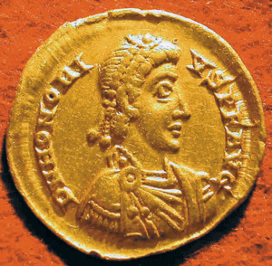 A Roman coin bears the image of Emperor Honorius.