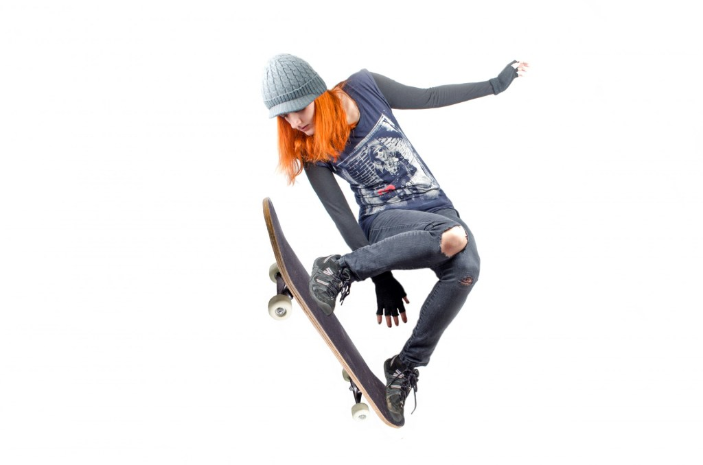 skateboarder woman jumping