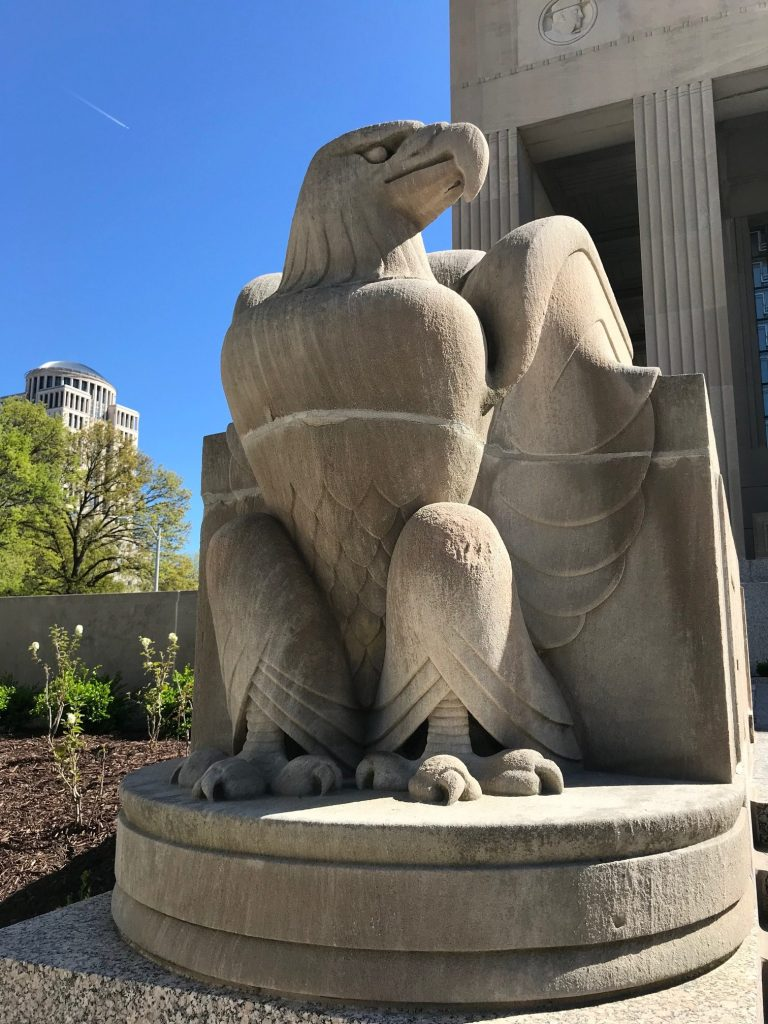 An eagle sculpture proudly sitting outside the war memorial.