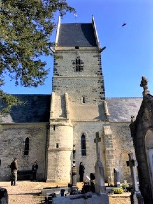 Famous church at Ste-Mere-Eglise, France, where paratrooper John Steele dangled from one of the spires.
