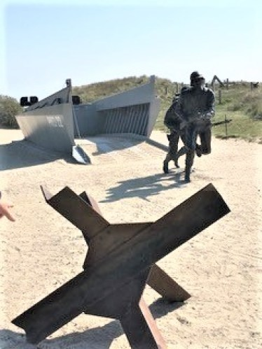 D-Day museum at Utah Beach with Higgins boat and soldier figures.