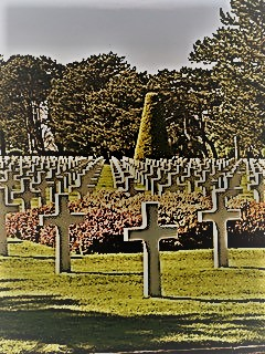 Grave markers at the Normandy American cemetery at Colleville-sur-Mer, France, with D-Day casualties.