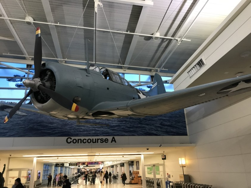 A model of a Douglas SBD-3 Dauntless dive bomber hanging from Chicago's Midway Airport Midway display.