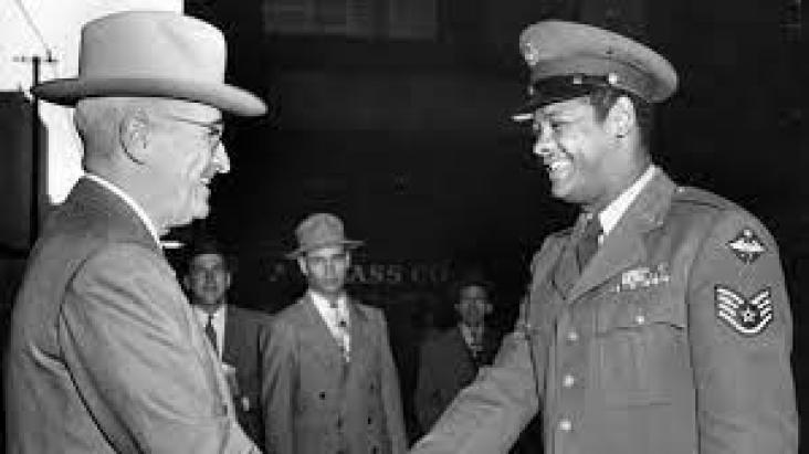 President Harry Truman ended segregation in the US Military in 1948. Here he congratulates a black Air Force sergeant.