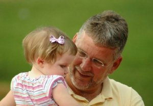 Tim Bayly holding child