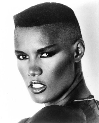 """Grace Jones is a Jamaican singer, lyricist, supermodel, record producer, and actress. In 1977 Jones secured a record deal with Island Records; she moved into dance and new wave music, often collaborating with the Compass Point All Stars. She scored Top 40 entries on the UK Singles Chart with """"Pull Up to the Bumper"""", """"I've Seen That Face Before"""", """"Private Life"""", """"Slave to the Rhythm"""" and """"I'm Not Perfect"""". Her most popular albums include Warm Leatherette (1980), Nightclubbing (1981), and Slave to the Rhythm (1985)."""