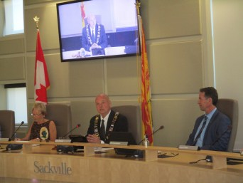 Mayor Higham (centre) presides at first Town Council meeting