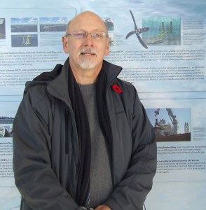 Jack Gallagher beside display of Black Rock turbines at FORCE visitor centre