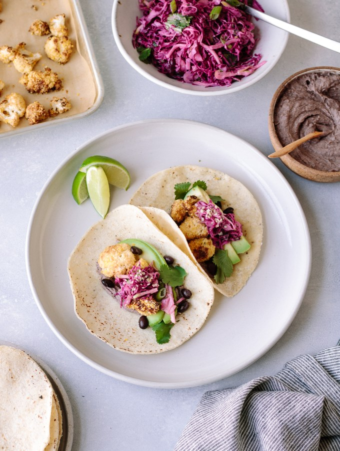 Crispy Cauliflower Tacos with Creamy Black Beans and Tangy Cabbage Slaw — warmandrosy.com
