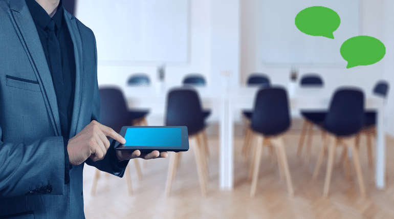 Featured Image for consulting page. Person holding a tablet device. Image has green consulting logo on it.