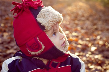 Toddler in Sydenham Woods in Autumn, photographed by Anna Hindocha/Warm Glow Photo