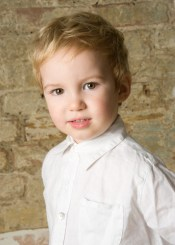 Children's portrait from pop-up studio at Serendipity Cafe in Streatham, by Anna Hindocha/Warm Glow Photo.