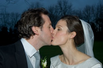 Bride and Groom kissing, New Year's Eve Wedding, Woodlands Park Hotel, Cobham. Photographed by Anna Hindocha/Warm Glow Photo