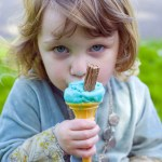 Girl eating an ice cream in the Rookery, Streatham Common, photographed by Anna Hindocha/Warm Glow Photo