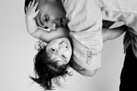 Black and white studio portrait of a baby girl and her father by Anna Hindocha/Warm Glow Photo