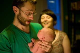 Newborn baby boy with his parents photographed by Anna Hindocha/Warm Glow Photo