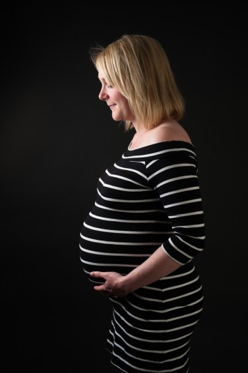 Studio photograph of a pregnant woman, by Anna Hindocha/Warm Glow Photo