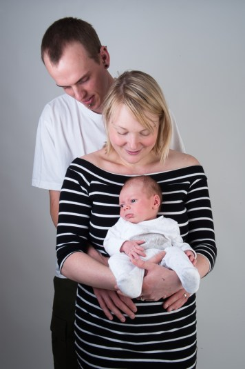 Studio photograph of parents with their newborn son by Anna Hindocha/Warm Glow Photo