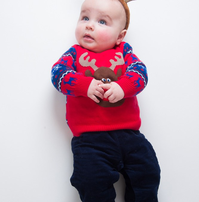 Baby boy in a Christmas jumper from studio shoot by Anna Hindocha/Warm Glow Photo