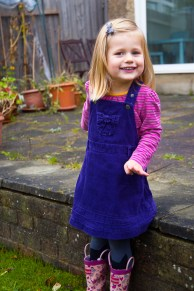 Young girl in her garden. Photographed at home by Anna Hindocha/Warm Glow Photo